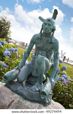 The old Indian Statue located in the center of historic Watch Hill Rhode Island. - stock photo