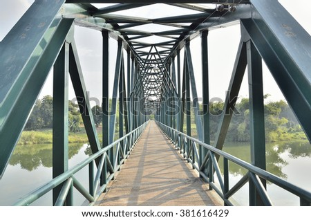 The old iron bridge in midday (Select focus)