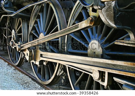 The old iron railway locomotive wheels. - stock photo