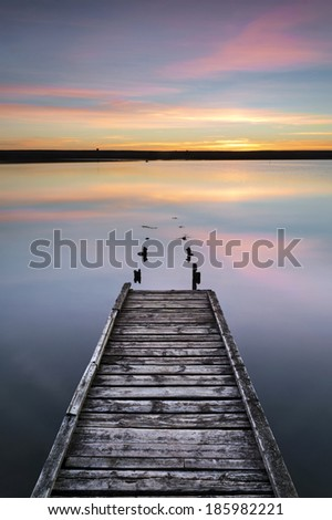 The old jetty located on chesil beach has seen better days but proves a popular haunt for photographers. - stock photo