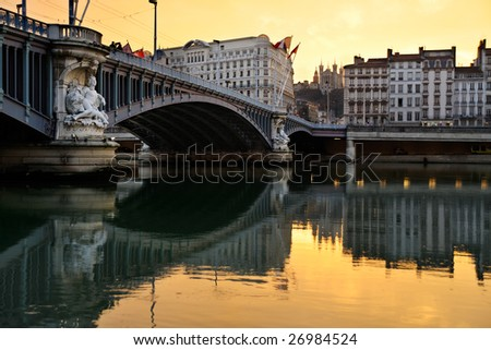The old Lafayette Bridge, in Lyon over the Rhine River. - stock photo