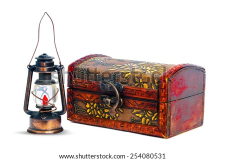 the old lamp and chest isolated on white background - stock photo