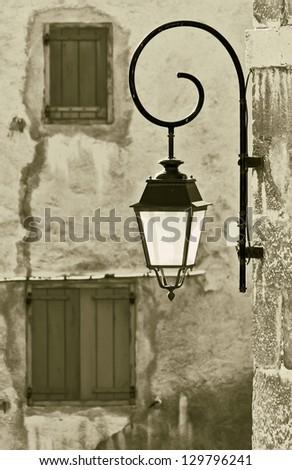 The old lantern - Briancon, France (stylized retro) - stock photo