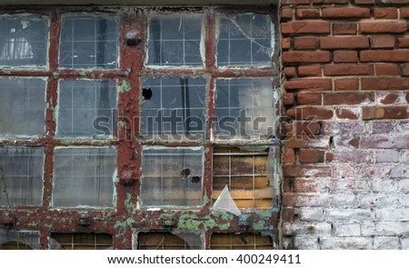 The old large broken window - stock photo