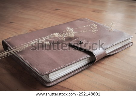 The old leather book for memo schedule diary  - stock photo