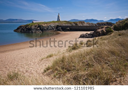 the old light house at llanddwyn island - stock photo