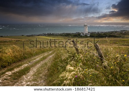 The old lower lighthouse at Portland Bill, Dorset, England now used as a bird observatory - stock photo