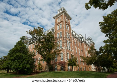 The Old Main clock tower - oldest building on the University of Arkansas campus - stock photo