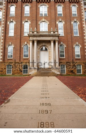 The Old Main with Senior Walk - oldest building on the University of Arkansas campus - stock photo