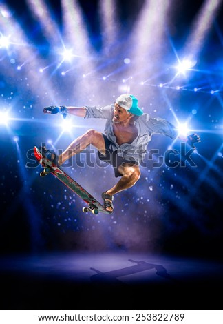 The old man is skating on the grand arena - stock photo