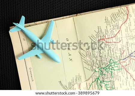 The old map and blue color jet plane toy model represent the tourism and travel industry concept related idea. - stock photo