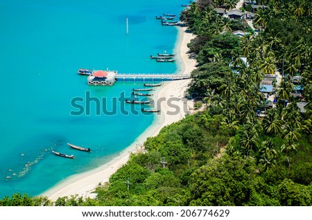 The Old marina or the pier or the port on the beach of fisherman living. Top view on the mountain Traditional fishing village is secluded and clear turquoise sea waters, small island, Thailand. - stock photo
