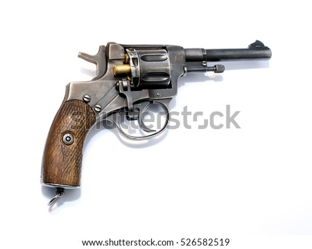 The old military weapons revolver with bullets charged in the drum and swivel sideways locking device