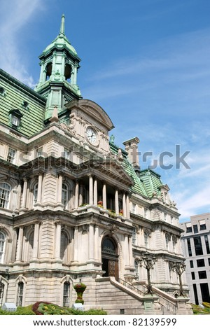 The old Montreal city hall (hotel de ville) on a cloudy day, main entrance detail. - stock photo