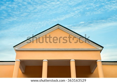 The old office building on background on blue sky - stock photo