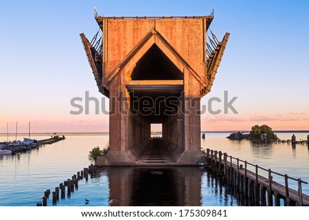 The old ore dock in the harbor at Marquette, Michigan, now in disuse, was used to unload railway ore cars into ships below. Shot near sunset. - stock photo