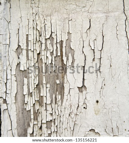 the old paint on a wooden fence - stock photo
