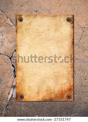 The old paper attached to the cracked wall - stock photo