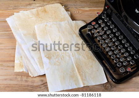The old paper on a wooden surface - stock photo