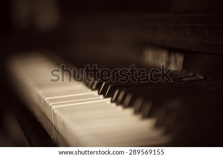 the old piano keyboard in monohrome shades - stock photo