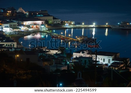 The old port town of Mykonos in the evening lights. Greece. - stock photo