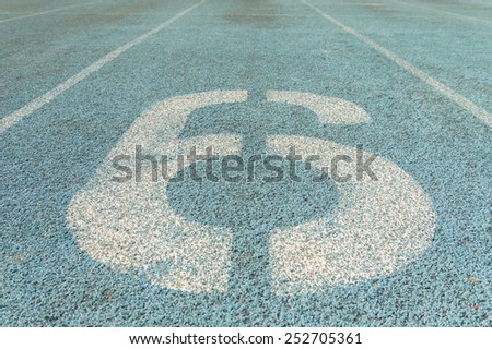 The old racetrack line number close up become dirty after use - stock photo