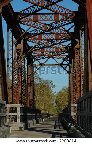The old railroad trestle bridge is now used for a fitness trail. - stock photo