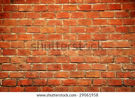 the old red brick city wall - stock photo