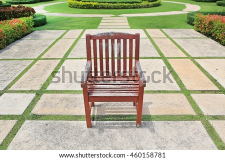 The old red brown wooden chair alone in the park