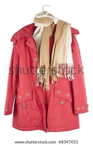 The old red female jacket hangs on a hanger isolated on white