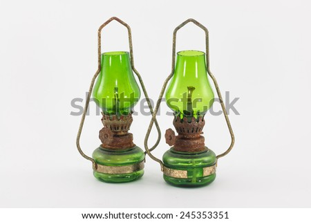 the old rusty kerosene lamp - stock photo