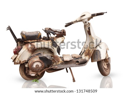 the old, rusty motorcycle is isolated on white background - stock photo