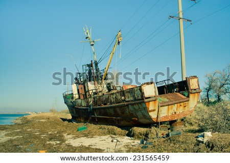 The old rusty ship, on a dump