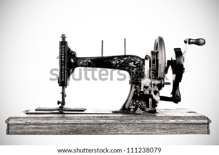 The old sewing machine on white background - stock photo