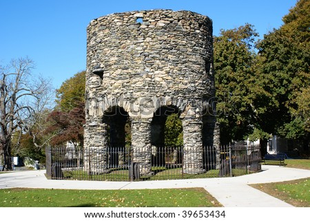 The Old Stone Mill in Newport, Rhode Island.  Theories abound as to its origin from Vikings to Native Americans, to colonists, to Governor Benedict Arnold.  No one is certain. - stock photo