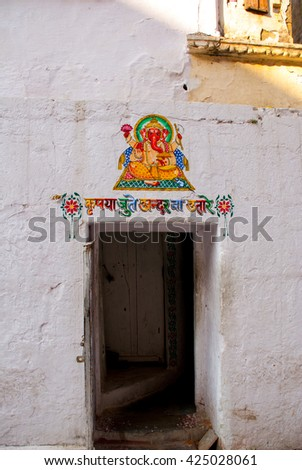 The old stone temple. Fragments of walls, the picture on the wall - painting. Udaipur, India - stock photo