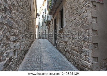 The old Street in the medieval quarter of Girona, Spain - stock photo