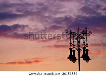 The old street lamp silhouette - stock photo
