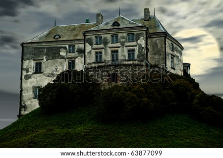 The old terrible castle. Castle in the western Ukraine on a background of the night sky with the moon - stock photo