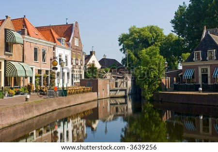 The old 16th century (1571) village of Spaarndam, the Netherlands, with the old inner harbor, it's sluices and locks, the fisherman's' houses - stock photo