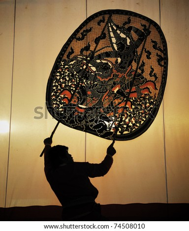 The old Thai traditional shadow puppet in Ratchaburi - stock photo