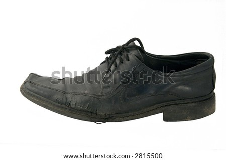 The old torn shoe on a white background - stock photo