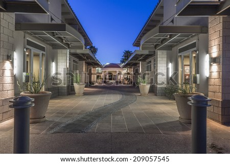 The Old Town Arts District of downtown Scottsdale Arizona  as the sun is setting showing the rotunda on Main Street. - stock photo