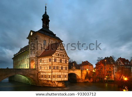 The Old Town Hall (Altes Rathaus) (1386) of Bamberg was built in the middle of the Regnitz river. The Old Town of Bamberg is listed as a UNESCO World Heritage. - stock photo