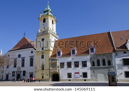 The Old Town Hall from 14th, 15th and 18th century with jesuit´s church on the Main Square in Bratislava, Slovakia. - stock photo