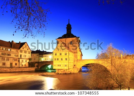 The Old Town Hall of Bamberg, Bavaria, Germany, inmidst the river Regnitz at night - stock photo