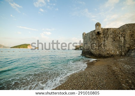 The old town of Budva on the Adriatic coast at sunset - stock photo