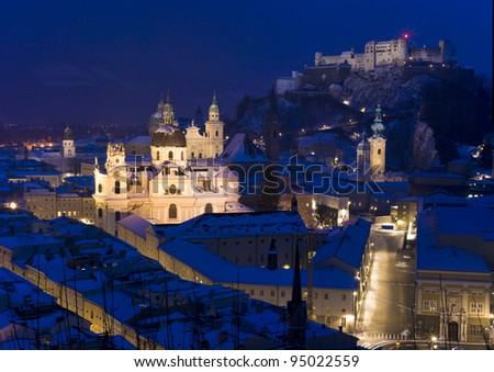 the old town of Salzburg in a very cold winter evening - stock photo