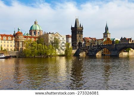 The Old Town with Charles Bridge (a.k.a. Stone Bridge, Kamenny most, Prague Bridge, Prazhski most)over Vltava river in Prague, Czech Republic. - stock photo