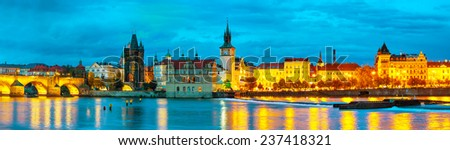 The Old Town with Charles bridge in Prague in the evening - stock photo